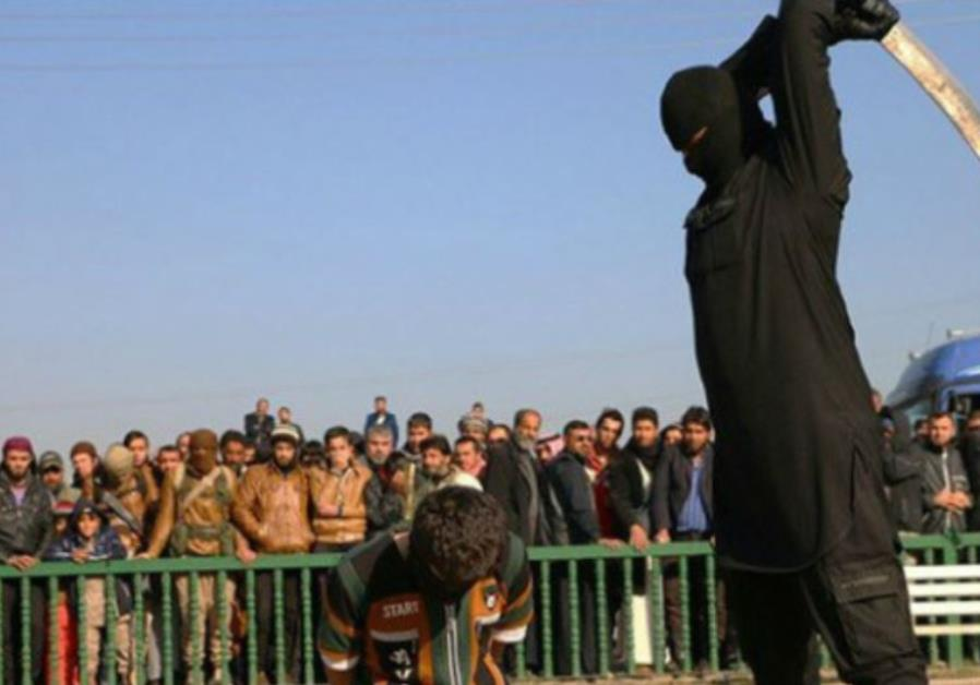 ISIS fighter beheading boy, 16, in Syria
