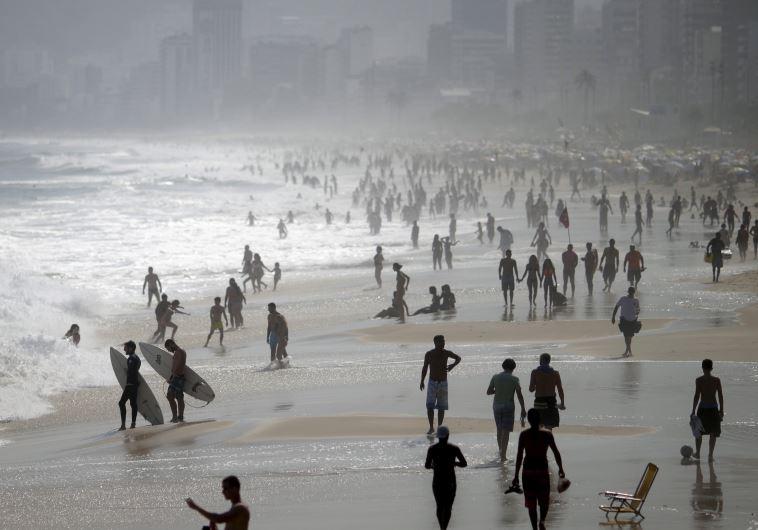 People gather in Ipanema beach in Rio De Janeiro, Brazil