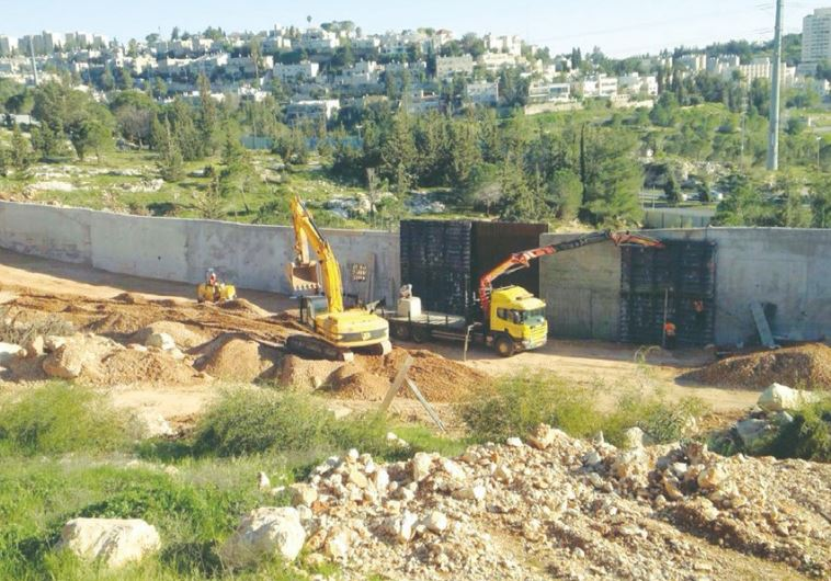 CONSTRUCTION VEHICLES prepare a housing site in the capital's Ramat Shlomo neighborhood last week.