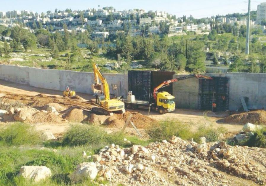 CONSTRUCTION VEHICLES prepare a housing site in the capital's Ramat Shlomo neighborhood last week.