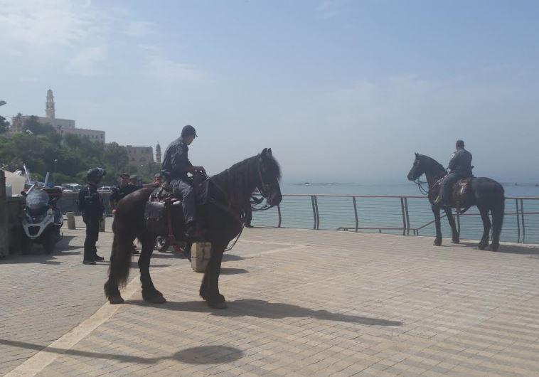 Police on seaside Tel Aviv-Jaffa promenade day after terror attack, March 9, 2016
