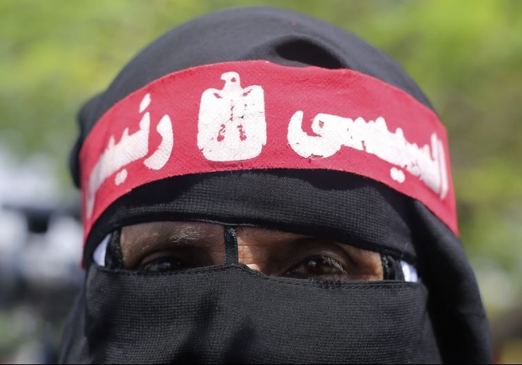 A supporter of of Egypt's new President Abdel Fattah al-Sisi wears a full veil (niqab)