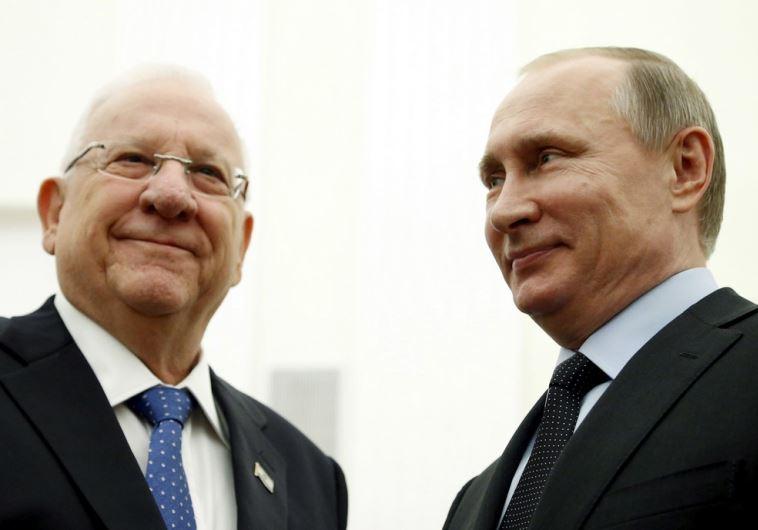Russia's President Vladimir Putin (R) meets with his Israeli counterpart Reuven Rivlin