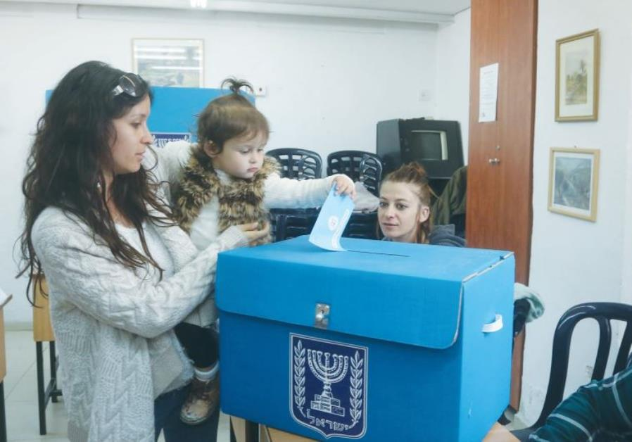A WOMAN casts a ballot in the March 2015 national election