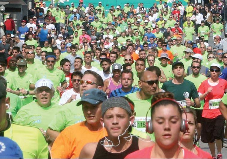 Runners participate in the fifth annual Jerusalem Marathon in 2015