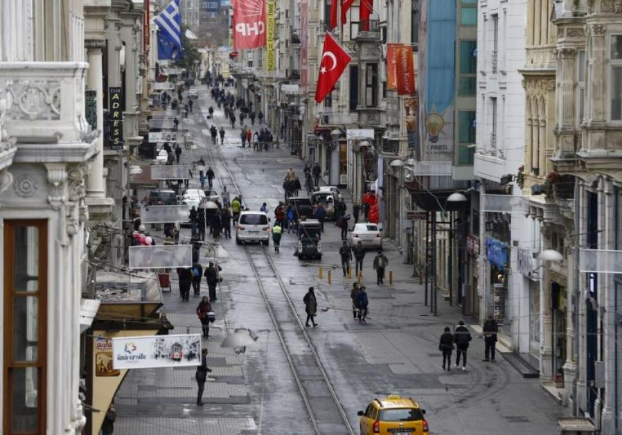 Pedestrians walk along Istiklal Street, a major shopping and tourist district, in central Istanbul