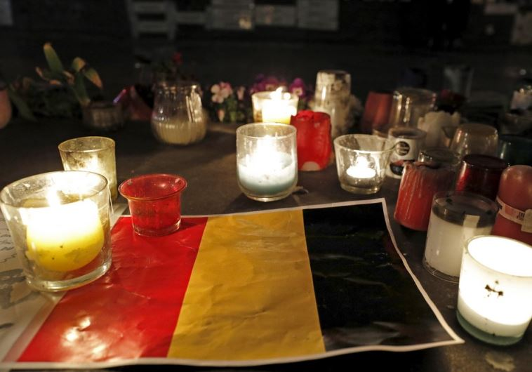 Candles are pictured around a Belgian flag on the Place de la Republique in Paris