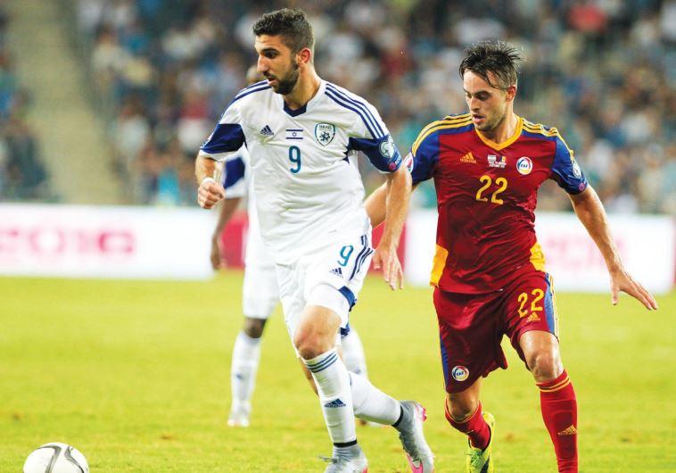 Israel striker Munas Dabbur (left)