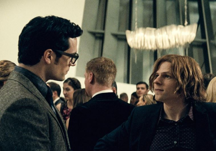 "Henry Cavill, left, as Clark Kent, and Jesse Eisenberg as Lex Luthor in ""Batman v. Superman: Dawn of"