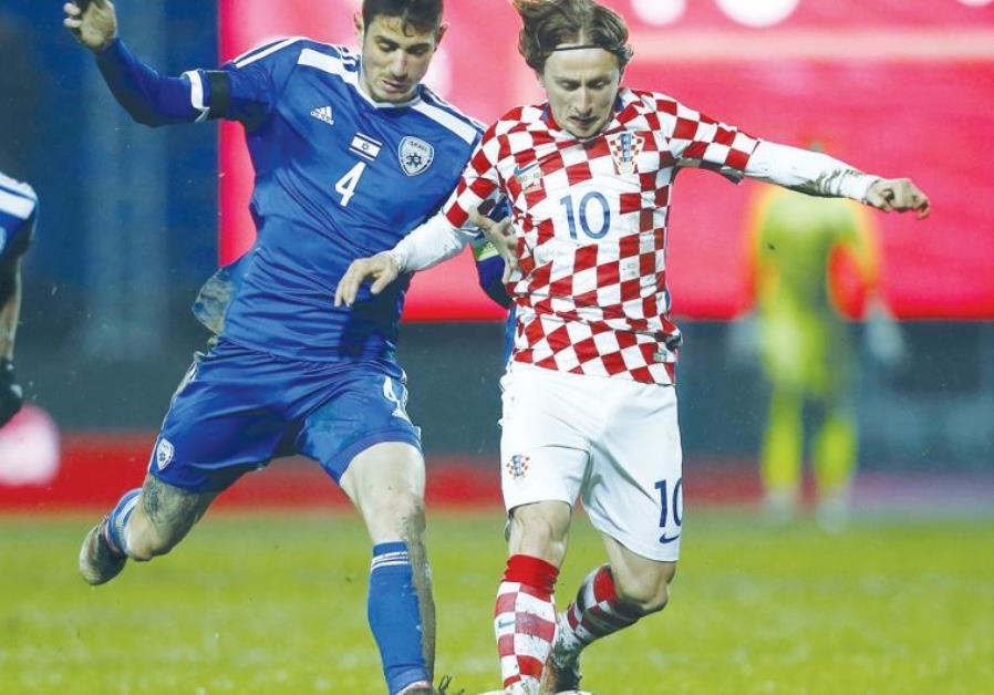 Israel midfielder Nir Biton (left) battles Croatia's Luka Modric for the ball