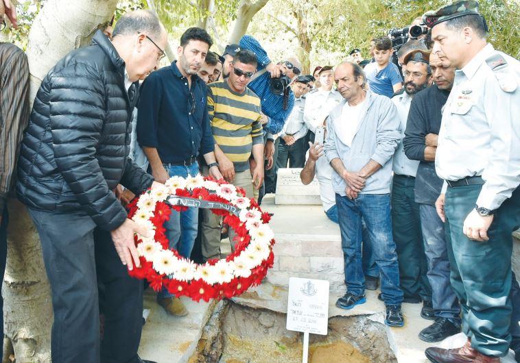 DEFENSE MINISTER Moshe Ya'alon lays a wreath on Brig.-Gen. Munir Amar's grave in Julis