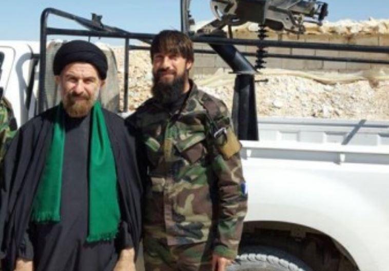 Ali Ghafari (left) next to Iranian fighter