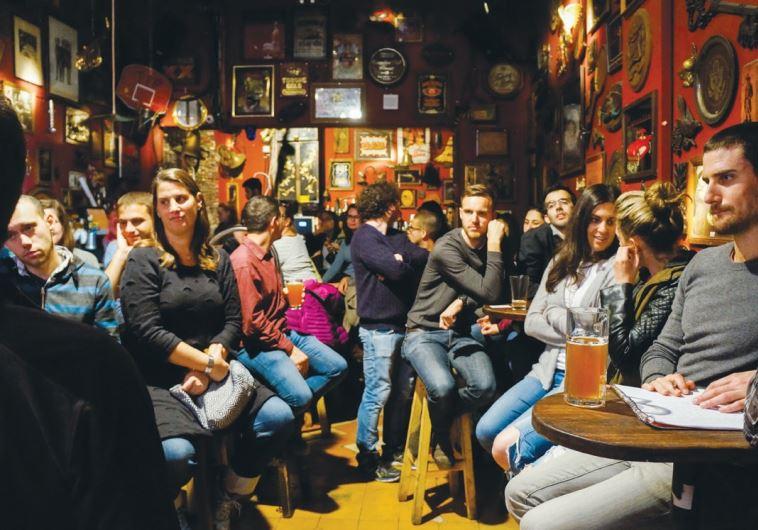 THE TEL AVIR group meets at Joey's Bar in Tel Aviv on Tuesday night.