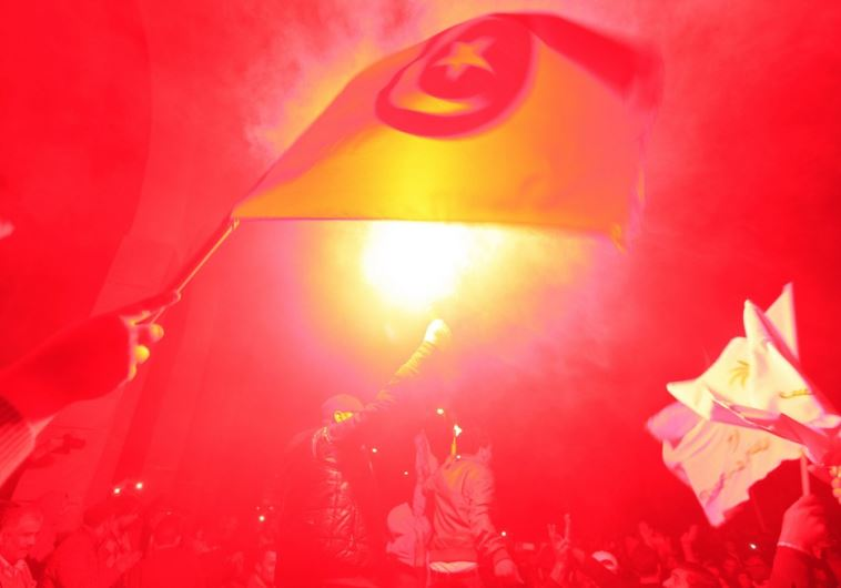 Tunisians celebrate an election