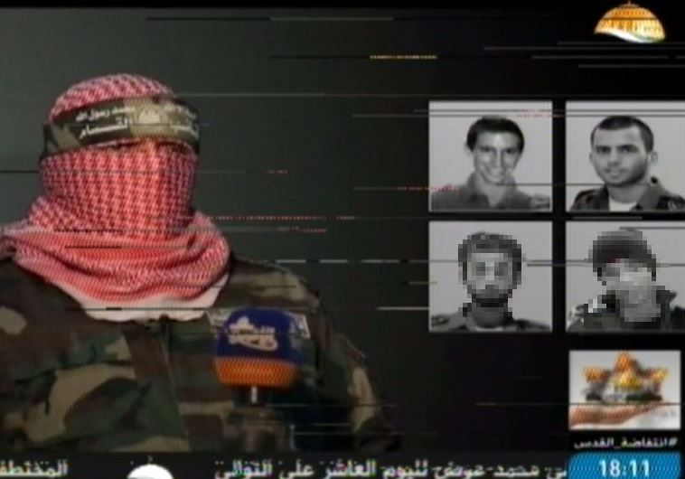 """Al Aksa TV footage of Hamas military wing showing images of four Israeli """"POWs"""""""