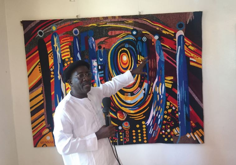 Kasse, a local artist shows some of his recent work at his studio in Dakar