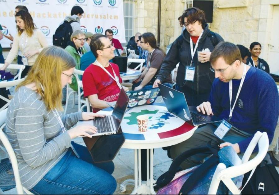 SOFTWARE DEVELOPERS from Israel and abroad work to improve the Wikipedia online encyclopedia