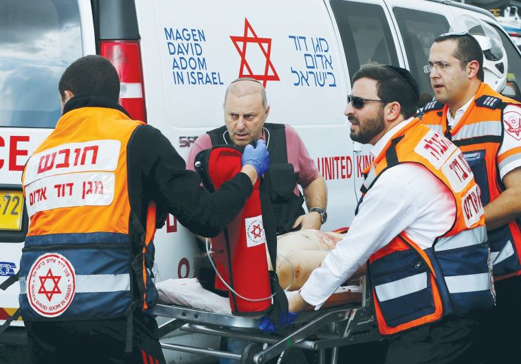 MDA MEDICS evacuate a Palestinian attacker in Jerusalem after a stabbing in October