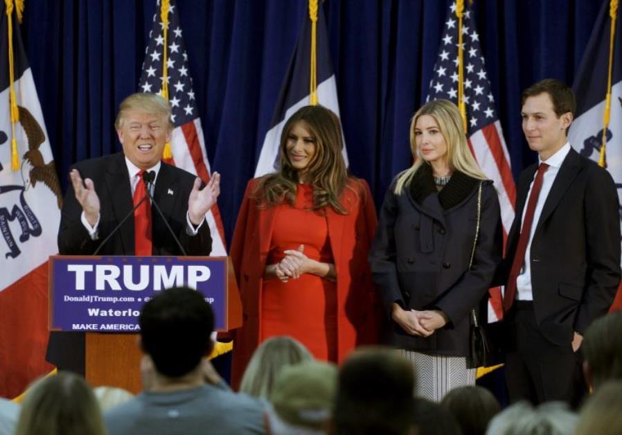US Republican presidential candidate Donald Trump speaks as (L-R) his wife Melania, daughter Ivanka