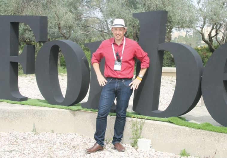 'FORBES' EDITOR Randall Lane poses at the magazine's '30 Under 30' summit at the Israel Museum yeste