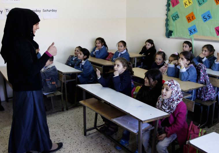 Syrian refugee children attend a lesson in their classroom, Lebanon