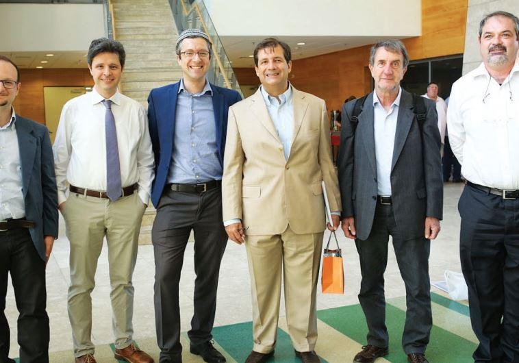 THE ITALIAN delegation poses for a photo with Italian Ambassador to Israel Francesco M. Talo (third