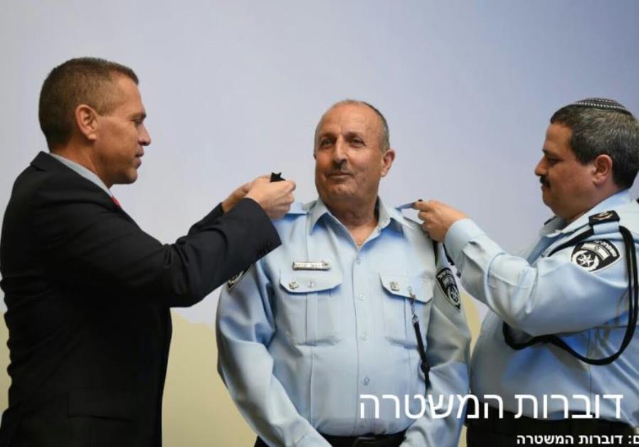 Gilad Erdan (left), Jamal Hachrush (center), and  Roni Alsheich