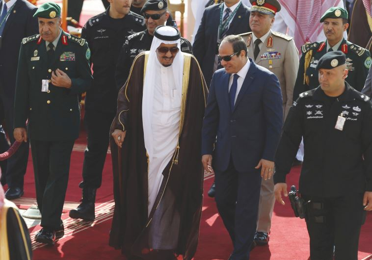 SAUDI KING Salman bin Abdulaziz, left, walks with Egypt's President Abdel Fattah al-Sisi in Riyadh