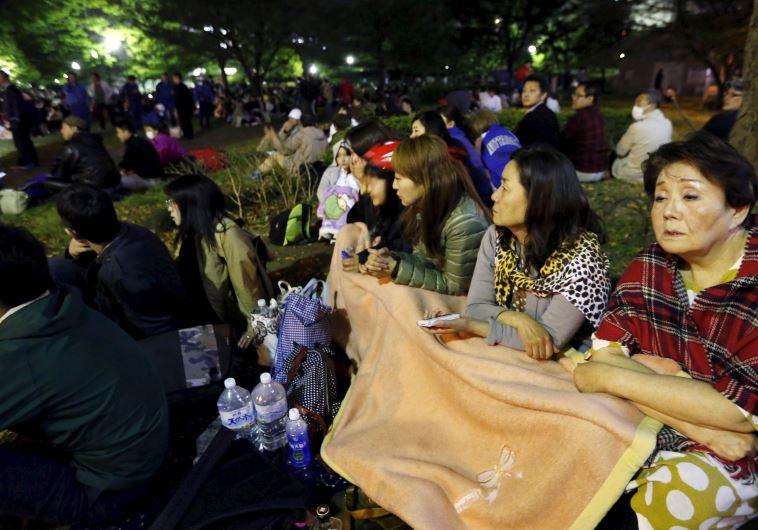 Evacuated residents gather at Shirakawa park after an earthquake in Kumamoto, southern Japan, in thi