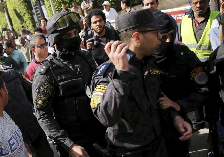 Egyptian protesters shout slogans and argue with police during a demonstration