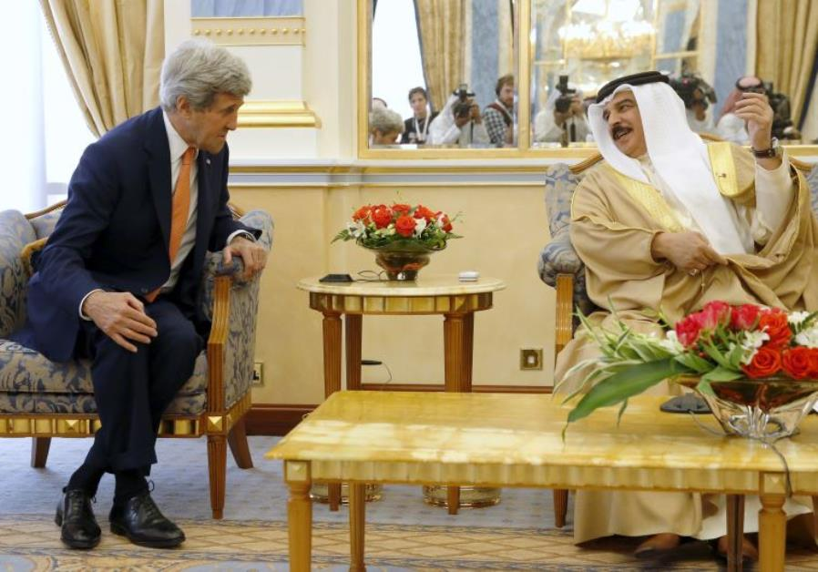 Bahrain's King Hamad bin Isa al Khalifa welcomes U.S. Secretary of State John Kerry at Gudaibiya Pal