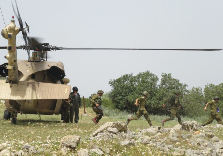 NAHAL INFANTRY soldiers take part in a drill with helicopters earlier this month in the North