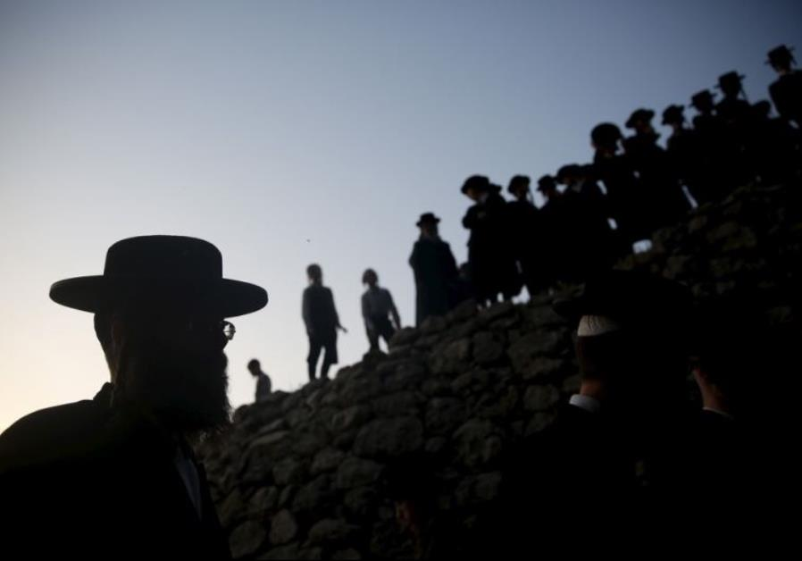 Ultra-Orthodox Jews take part in the 'Mayim Shelanu' ceremony to collect water from a natural spring