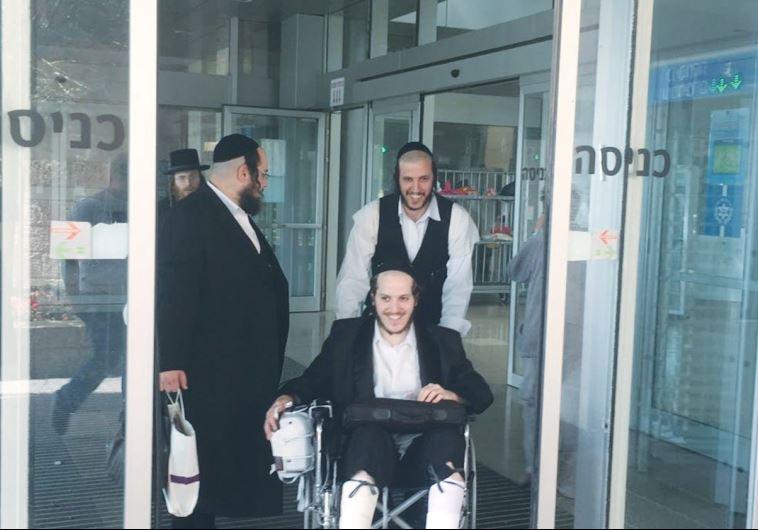 CHAIM WINTERNITZ is wheeled out of Jerusalem's Hadassah-University Medical Center in Ein Kerem