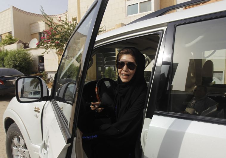 Female driver Azza Al Shmasani alights from her car after driving in defiance of the ban in Riyadh J