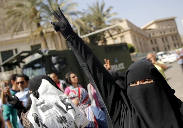 A Muslim Brotherhood member shouts slogans during an anti-government protest in Cairo