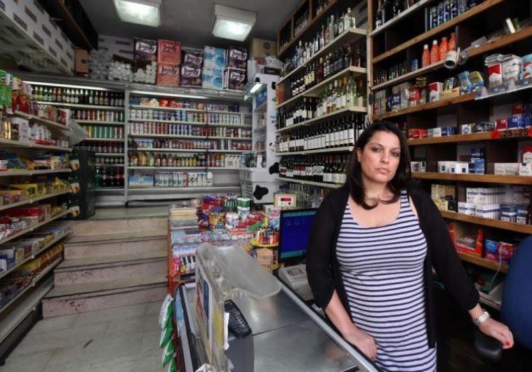 An employee of Makolet 24-hour Market on Hillel Street