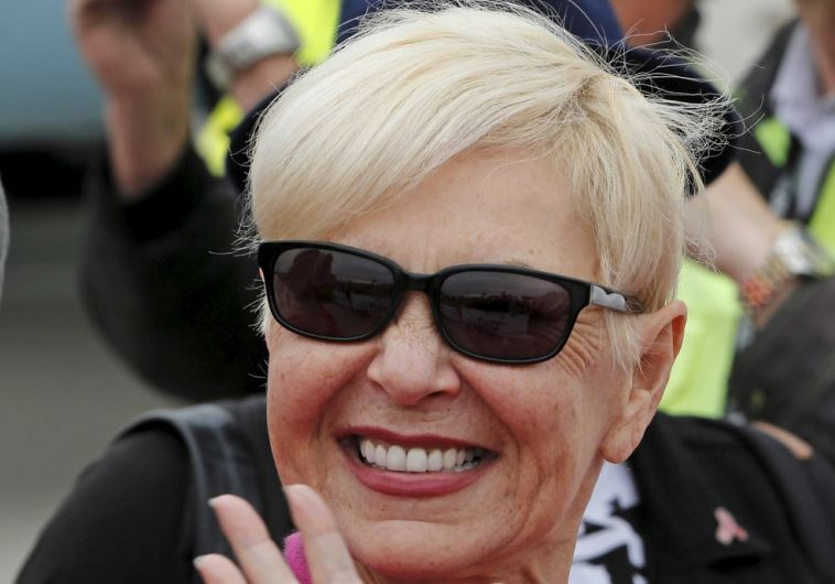Actress Roseanne Barr poses upon her arrival for the Life Ball at the airport in Vienna