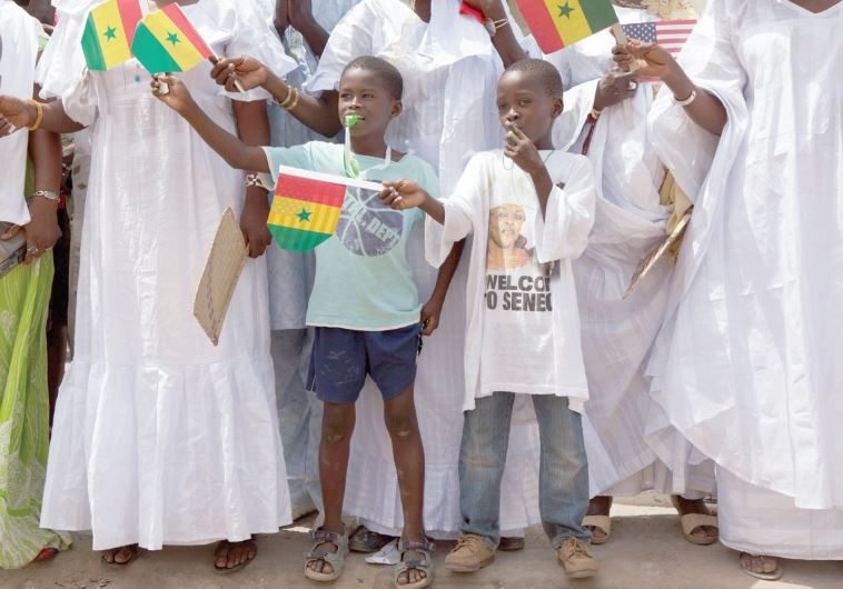 YOUNG SENEGALESE welcome US President Barack Obama to a school in Senegal in 2013