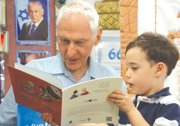 HAROLD GRINSPOON reads to a child