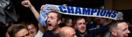 Leicester City supporters celebrate their team's English Premier League title at a pub in Leicester