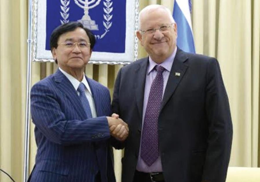 PRESIDENT REUVEN RIVLIN with Dr. Yoshimitsu Kobayashi, chairman of the Mitsubishi Chemical Corp.