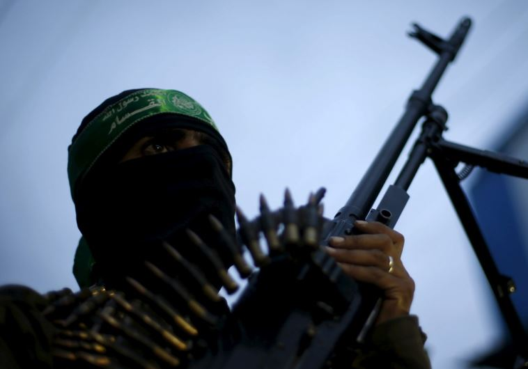A Palestinian Hamas militant takes part in a rally