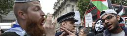 Supporters of Israel and the Palestinians argue during a demonstration in London