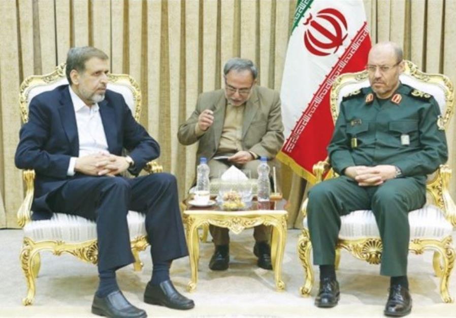 ISLAMIC JIHAD leader Ramadan Shalah (left) meets with Iranian Defense Minister Hossein Dehqan