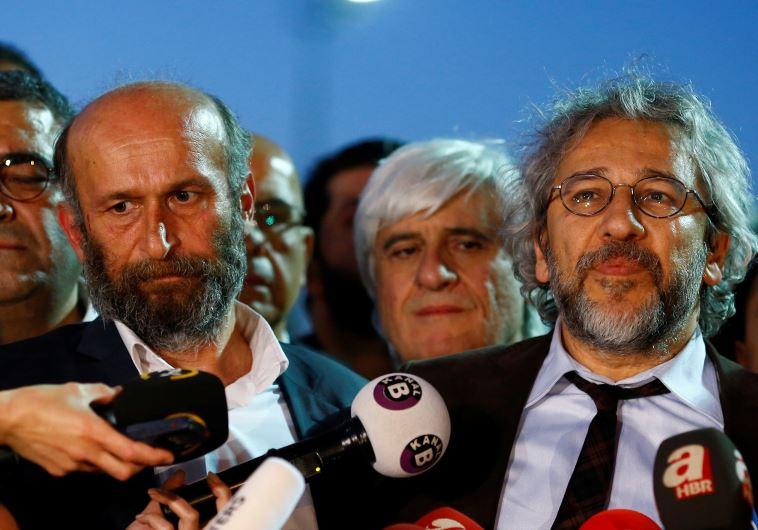 Can Dundar (R), editor-in-chief of Cumhuriyet, accompanied by his Ankara bureau chief Erdem Gul