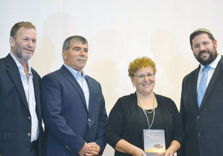 MIRIAM PERETZ, the mother of two fallen IDF soldiers, is honored at Begin Heritage Center