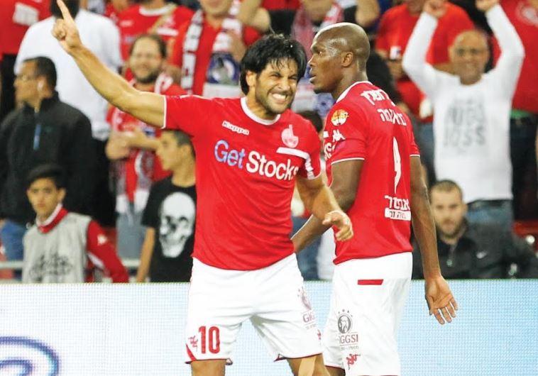 Hapoel Beersheba striker Elyaniv Barda (left) celebrates with teammate Anthony Nwakaeme