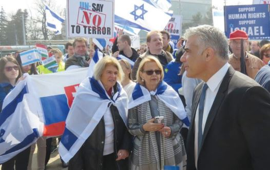 Yesh Atid Chairman Yair Lapid attends a pro-Israel rally in front of the UN Human Rights Council in Geneva in March (credit: YESH ATID)