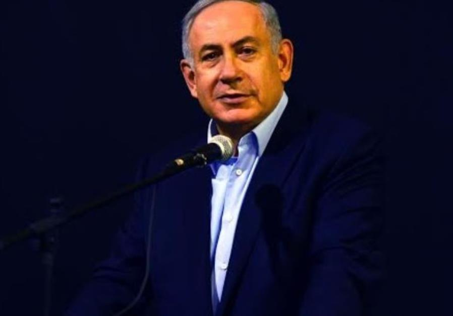 Benjamin Netanyahu speaking at a ceremony for fallen soldiers.